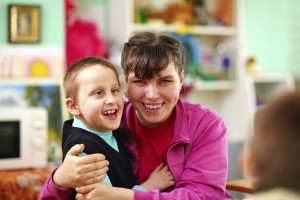 Young boy with disability with mum