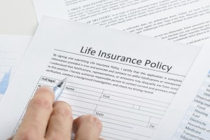 Person Filling Application For Life Insurance